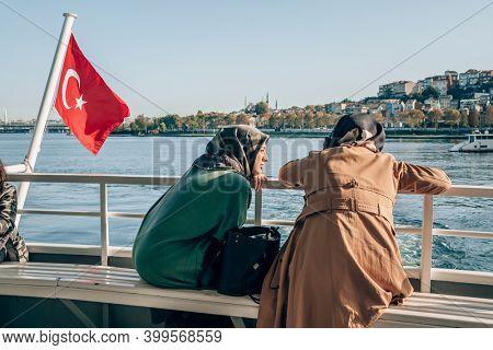 Istanbul, Turkey - October 10, 2019: Unidentified turkish women traveling on the ferry through Bosphorus in istanbul, Turkey