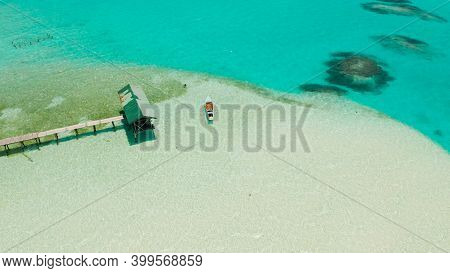Sandy Beach With And Azure Water, Boat Of The Lagoon, Copy Space For Text, Top View. Sea Water Surfa