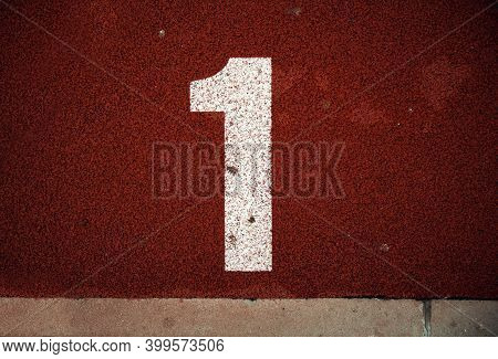 Closeup View Of Number On Athlete Path.