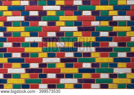 Colorful Brick Wall, Closeup View. Texture And Design Details.