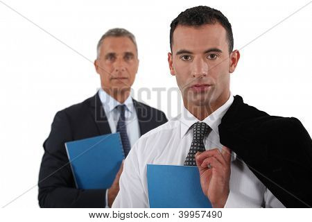 Young businessman posing with his boss