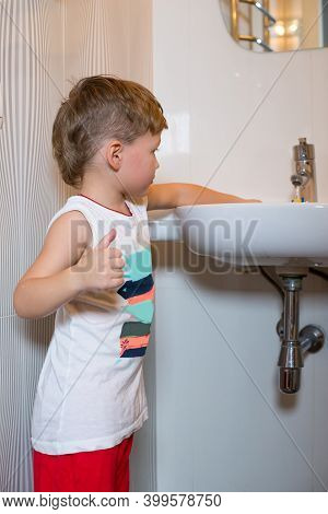 Little Boy Wets His Hands In The Washbasin.