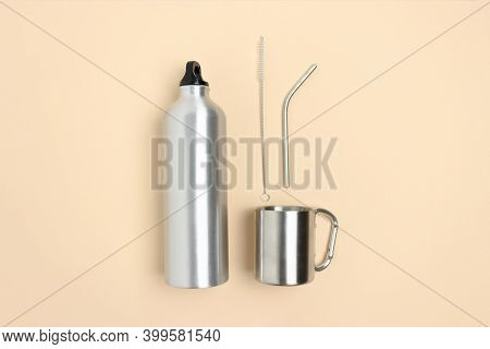 Flatlay Of Bottle, Mug, Metal Tube And Cleaning Brush On Beige Background.