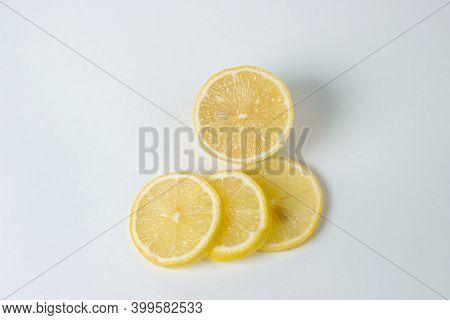 Lemons On A White Background. Citrus Fruit. Healthy Food. Sliced Lemon. Sour Fruit