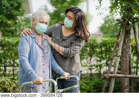 Asian Senior Or Elderly Old Lady Woman Walk With Walker And Wearing A Face Mask For Protect Safety I