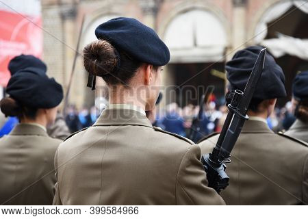 Back View Of Military Woman With A Bayonet Rifle - Detail With Uniformed Women Standing For The Mili