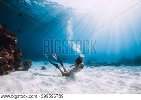 Young Woman Freediver Make Bubbles In Deep Sea. Freediving In Blue Ocean