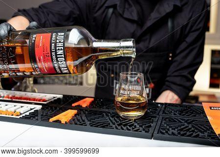 Kiyv, Ukraine, November 22, 2020. Bartender Pours Single Malt Auchentoshan \
