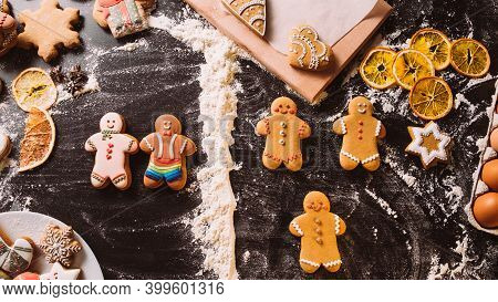 Gay Christmas Bakery. Lgbt Pastry Party. Sexual Identity. White Rainbow Icing Gingerbread Men Cookie