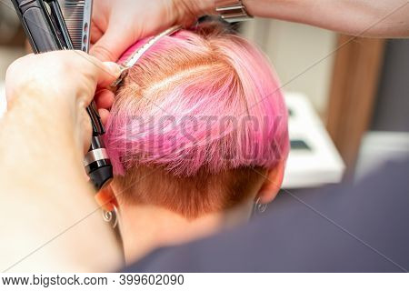 Hairdresser Pinches Hair With The Clip Before Doing Hairstyle In A Hair Salon