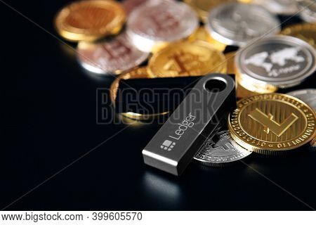 UKRAINE, ROVNO - On 4 December: Ledger hardware wallet for cryptocurrency on a black background