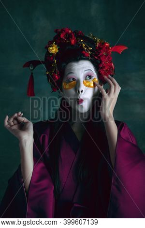 Trendy Eyewear. Young Japanese Woman As Geisha Isolated On Dark Green Background. Retro Style, Compa