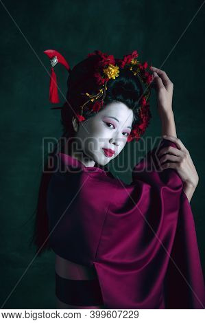 Portrait. Young Japanese Woman As Geisha Isolated On Dark Green Background. Retro Style, Comparison