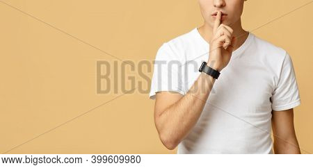 Hush, Stop Talking, Confidential Information And Secret. Mysterious Young Blogger Student Man In Whi