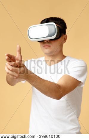 Virtual World, Modern Entertainment Games. Serious Concentrated Young Teen Student Male In Vr Glasse