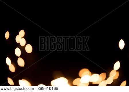Christmas Background Overlay. Abstract Christmas Dark Background With Defocused Garland / Dark Backg