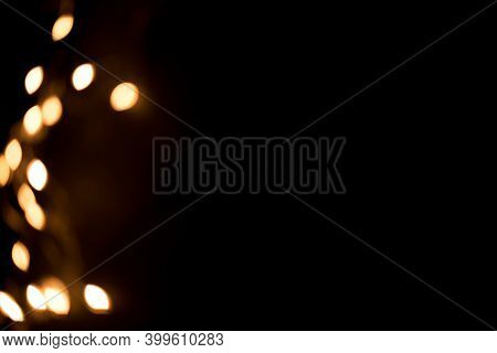 Gold Bokeh Lights On Black Background. Christmas Background Overlay. Abstract Christmas Dark Backgro