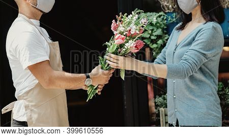 Florist Owner Of Small Business Holding Flowers For Delivery To Customers At Store. Young Owner Guy