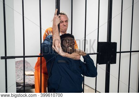 A Wild Homicidal Maniac Sentenced To Life In Prison Attacks The Warden And Strangles Him