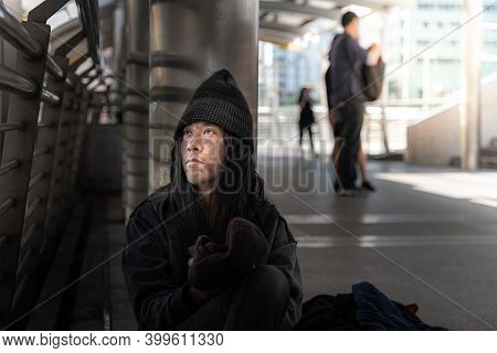 Beggars, Homeless People Sitting On The Floor, Discouraged And Desperate, Ask For A Fraction Of Mone