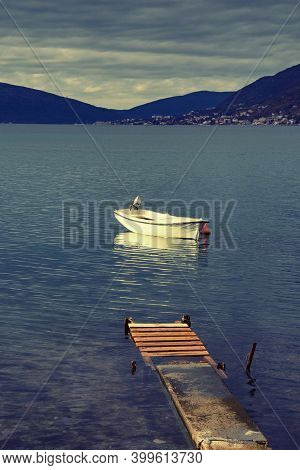 Overcast. Montenegro, Adriatic Sea. View Of The Bay Of Kotor Near The Town Of Tivat. Fishing Boat On