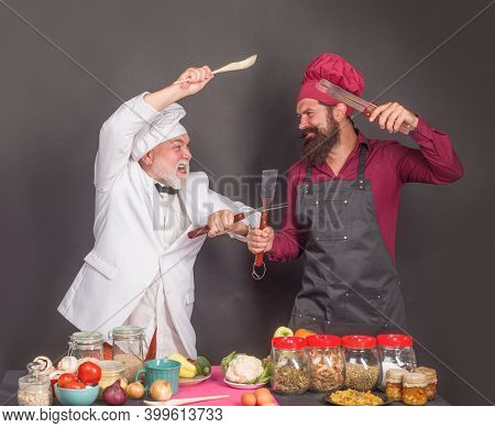 Chefs On Kitchen. Two Chefs Fighting On Kitchen. Kitchen. Cooking. Beared Chef Man. Male Chef In Uni