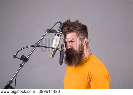 Studio Records. Bearded Man Sing In Microphone. Microphone. Sings A Song. Karaoke. Man Singing With