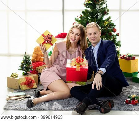 Merry Christmas And Happy New Year Copy Space,couples Holding Gift Boxes With Smiles