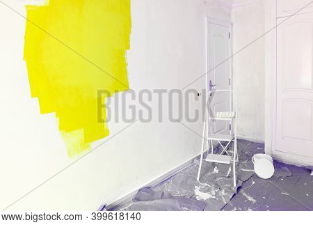 Home Renovation Concept - Old Flat During Restoration Or Refurbishment With Illuminating Yellow Pain