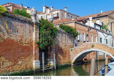 Venice, Italy. Small Private Bridge Over The Channel On Background Of Old Houses
