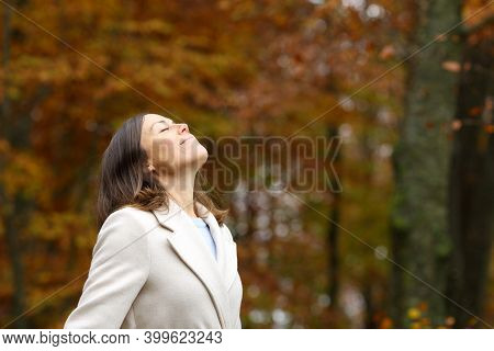 Adult Woman Breathing Fresh Air Standing In A Park In Autumn