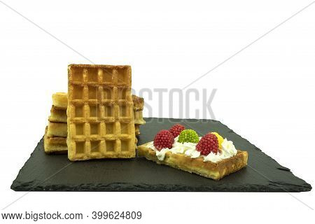 Jelly Candies Of Different Colors And Delicious Belgian Waffles On A White Isolated Background. Swee