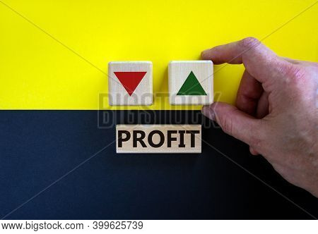 Growth Of Profit Symbol. Businessman Holds A Cube With Up Icon. Wooden Block With Word 'profit'. Bea