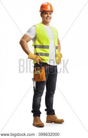 Full length shot of a construction worker with a helmet and tool belt isolated on white background