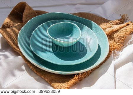 Set Of Ceramic Plates With Sackcloth Decorative Textile On White Background. Ceramic Tableware, Beau