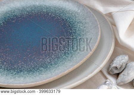 Detailed Of Ceramic Plates On Calico. Ceramic Tableware, Beautiful Arrangement.