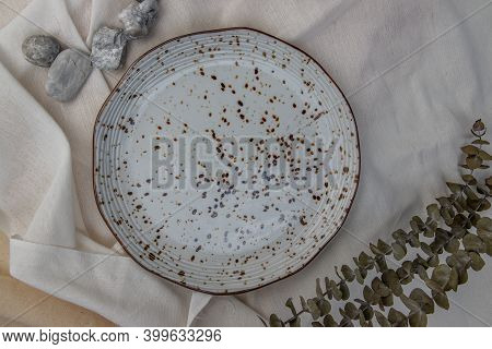 Ceramic Plates With Dried Flowers On Calico. Ceramic Tableware, Beautiful Arrangement.