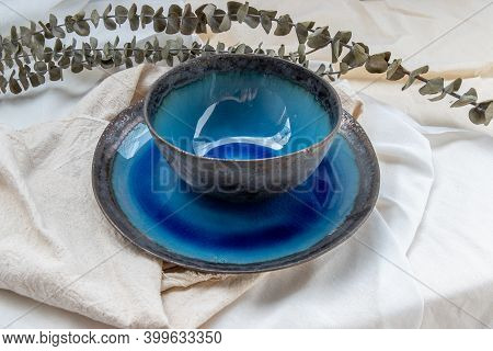 Set Of Ceramic Bowl With Dried Flowers On Calico. Ceramic Tableware, Beautiful Arrangement.