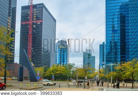 Brussels, Belgium - October 15, 2019: People Walking At  Financial And Business Downtown Street Of B