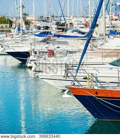 Side View Of Yachts And Motorboats Moored In Marina Of Larnaca, Bright Sunny Day, Cyprus