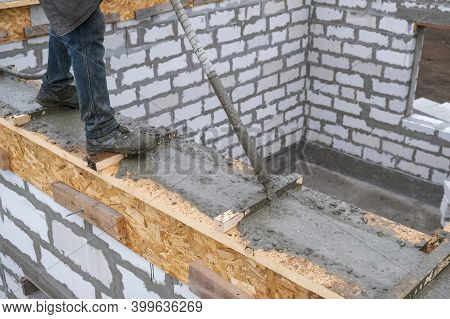 Pouring Concrete Into The Formwork At The Construction Site