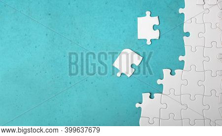 Many white piece of puzzle on blue background