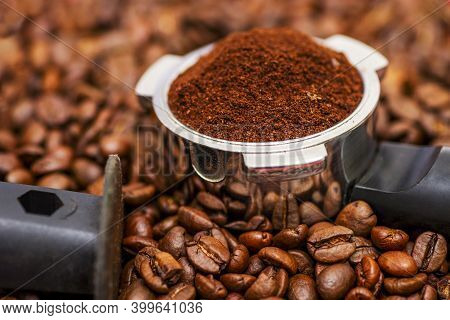 Freshly Ground Coffee In A Metal Filter On Background Coffee Beans. Espresso Filter Holder For Coffe