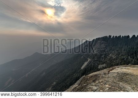 View From Moro Rock At Sequoia National Park With Hazy Mountains In Background Following California