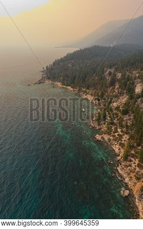 Secret Cove Along Lake Tahoe In Nevada With A Hazy Sky Due To Nearby Forest Fires In California.