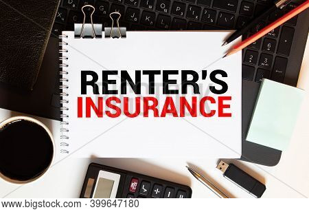 Notebook With Tools And Notes About Renter Insurance, Concept