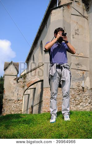 Tourist photographing ruins