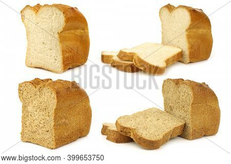 cut loaf of wholemeal bread, white bread and some slices on a white background