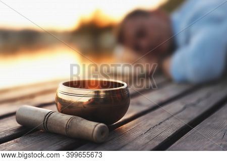 Man At Healing Session Outdoors, Focus On Singing Bowl