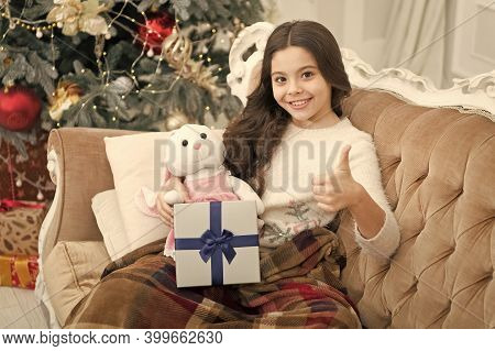 Winter Decorations. Magical Atmosphere. Boxing Day. Open Gift. Winter Wonderland. Adorable Girl Play